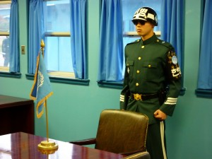 ROK Guard and the UN flag on the Military Demarcation Line (taken from North Korea)